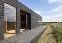 Carl Turner Architects made the Stealth Barn by tranforming a rustic structure into a unique guest house.