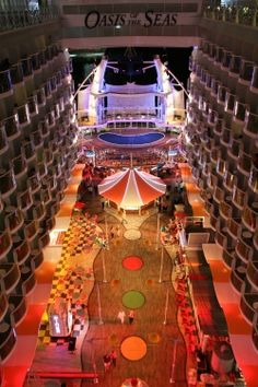 Stroll the boardwalk at night. Oasis of the Seas' aft neighborhood features a carousel, carnival games, a psychic and an ice cream shop.