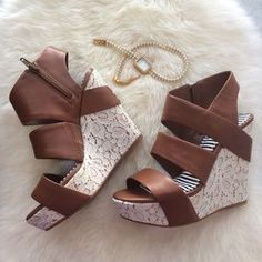 I just discovered this while shopping on Poshmark: HP Gianni Bini Wedges. Check it out! Price: $60 Size: 6, listed by mizzpinay1980
