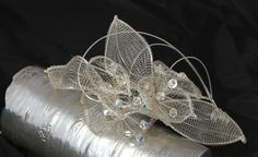 So pretty and fresh. This is a compilation of wire mesh lillies and leaves. The leaves have a wire frame and there is an added wire structure Tarnished Silver, Wire Frame, Wire Mesh, Bridal Headpieces, Color Themes, Bespoke, Swarovski Crystals, Leaves, Fresh