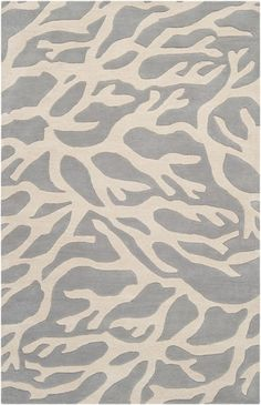 This beachy rug features a light gray coral pattern. The Escape rug collection offers coastal-inspired luxurious rugs in 100% New Zealand Wool. These h