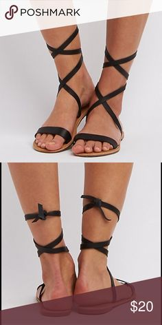 """Strapped Ankle Sandals Size 7. Only worn to try on. Selling because I have one in white already. Flat straps of faux leather sculpt a super sleek sandal with twin pieces that lace around the ankle and tie a Spartan knot in back. Single strap creates a simple vamp, continuing the no-frills footwear trend.  Non-skid rubber sole Brand: Charlotte Russe Product Fit: Heel: 0.25"""" Charlotte Russe Shoes Sandals"""