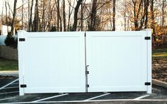 Great install of an Illusions Vinyl Fence dumpster enclosure by Campanella Fence Company