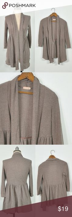 """Urban Outfitters Brown Wrap Cardigan Shawl Collar adorable brown wrap cardigan w/shawl collar, skirted hem + long sleeves. 48% polyester, 36% rayon + 3% spandex  -MEASUREMENTS- Tag Size: small Length: 27"""" Shoulders: 14"""" Sleeve Length: 17"""" Chest: 32"""" Waist Hem: 42""""  BRAND: Urban Outfitters' Pins + Needles CONDITION: excellent preowned condition Urban Outfitters Sweaters Cardigans"""