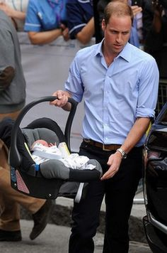 Heading home from the hospital - Prince William carries the royal baby to the car.PNG