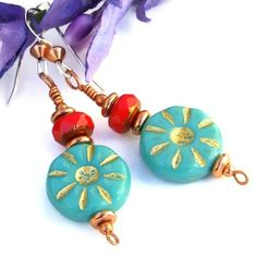 With cheerful turquoise blue and gold daisies and a pop of bright red color…