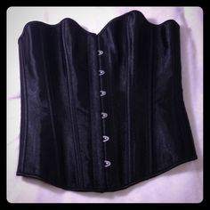 Black lace up corset Nice corset with boning and modesty panel. Too large for me when I purchased and I've lost weight so I will never wear it. Have another in white! Other