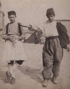 Boys in Istanbul, 1890-92.  The one on the left wears a costume from the Balkans (northern Greece, Albania or Kosovo).