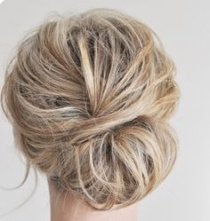 I like the bun part of this prom hair