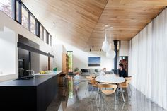 Light and bright inside but with a darker, more dramatic exterior, this timber-clad extension to a late-nineteenth-century home blends contemporary design with a historical context.