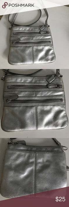 Coach Silver Metallic Leather Crossbody Coach Silver Metallic Crossbody. Two zippered pockets in front. One large pocket in back. Two interior pockets  All leather bag/shoulder strap Two scoff spots in front (see last picture) Coach Bags Crossbody Bags