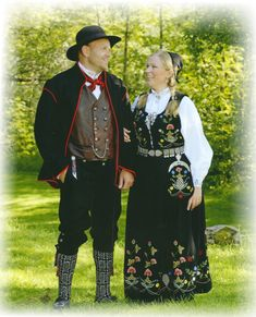 Hurdal bunad Norway~ The main motif consists of a spruce pinecone, the symbol on Hurdal's coat of arms, and the Hurdal rose. There are also wildflowers from the region. The two costumes are approved from the newest costume lexicon. Elder Futhark, Going Out Of Business, Folk Costume, Coat Of Arms, Costumes For Women, Norway, Two By Two, Wildflowers, Culture
