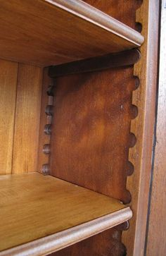 Even in the 19th Century, people had a need for adjustable shelving. A retailer might need to change shelf heights to display new wares; and on the domestic front, if you purchased a Sega Genesis and then upgraded to the Dreamcast, the boxes were different sizes. An unknown craftsperson solved
