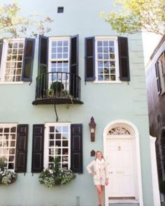 Love the seafoam house with black shutters