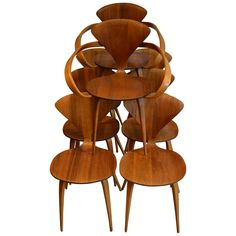Norman Cherner for Plycraft Walnut and Beech Dining Chairs, 1950s | From a unique collection of antique and modern dining room chairs at https://www.1stdibs.com/furniture/seating/dining-room-chairs/
