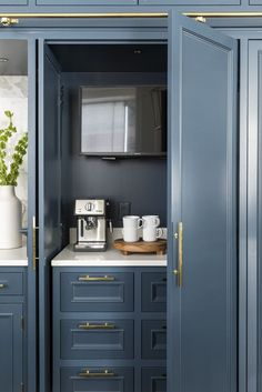 half white, half Prussian blue, all time-honored modern kitchen design. hidden tv and coffee bar. Blue Kitchen Designs, Modern Kitchen Design, Modern Kitchens, Kitchen Interior, Kitchen Decor, Kitchen Ideas, Layout Design, Design Ideas, Kitchen Butlers Pantry