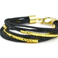 Simple cords and tube beads create a layered look in gold and black - DIY tutorial.