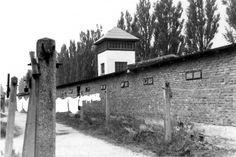 Dachau, Germany, Postwar, The west fence and a guard tower. - Yad Vashem Photo Archive