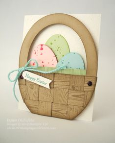 handcrafted Easter card by Dawn Olchefske ... luv how she used hardwood stamp for wood grain ad then wove the strips into a basket .. fun oval eggs with spats of tone on tone color ... wonderful card!