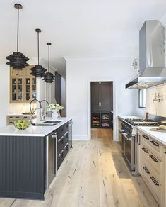 Two-toned, gourmet kitchen designed by Arianne Bellizaire Interiors featuring Zephyr hood, Brizo faucets and Top Knobs hardware Luxury Kitchen Design, Kitchen Style, Gourmet Kitchen Design, Cabinetry Design, Kitchen Trends, Home Kitchens, Cool Kitchens, Kitchen Interior, Tuscan Kitchen