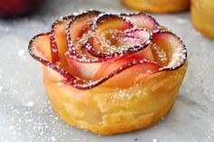 This dessert has the winning factors of easy to make and delicious. Puff Pastry Apple Rosettes that are crisp make a delicious dessert. This is a must-try