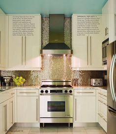 Love the hood fan and almost sequin-like tiles the go from backsplash to ceiling.