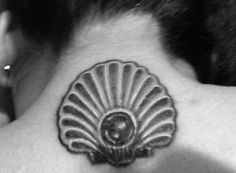The Pearl and the Oyster Shell located on the nape of my neck. Inspired by a jewelry piece found on Pinterest.  Sketched and inked by Todd of Aces High Tattoo in Fullerton, CA