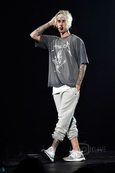 Justin Bieber wearing Adidas Ultra Boost Sneakers, Champion x Justin Bieber Purposetour Sweatpants, Fan Merchandise Metallica No Where Else To Roam T-Shirt