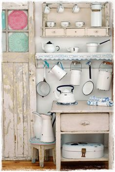 Back to the blue Cottage in Russia. Not so different from us. Nice pastels, old pieces she has gathered together from family and thrift stores.