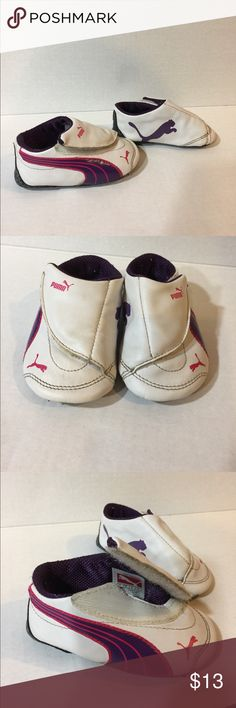 Baby girl puma shoes Soft bottom crib or house shoes are in great condition. Features Velcro for easy access. Great for first time walkers. Does need a light cleaning. Puma Shoes Baby & Walker