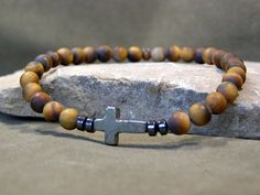 Hey, I found this really awesome Etsy listing at https://www.etsy.com/listing/168110663/mens-cross-bracelet-matte-tiger-eye