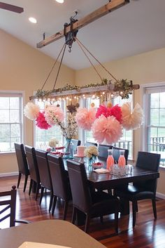This is obviously decorated for a party... but the table and the light fixture i love.