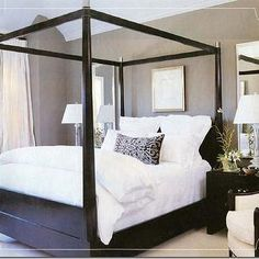 bedrooms - canopy bed, black canopy bed, taupe walls, taupe and black bedroom, mirrored over nightstand, mirrors above nightstand,  chic black