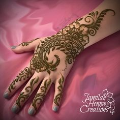 Party henna design with flowers and bold swirls www.JamilahHennaCreations.com