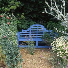 A classic Lutyens bench introduces the idea of adding garden color with paint instead of flowers. - Traditional Home ®
