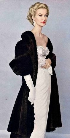 1952 - classic and timeless style!  white evening gown with black evening coat and classic make-up and hair