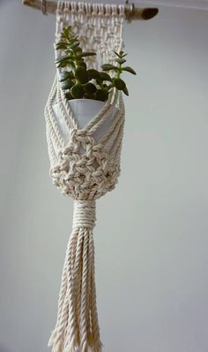 Macrame Wall Plant Hanger. This item is suitable for Small to Medium Plant. Handmade out of 3mm 100% Canadian Cotton Rope and Natural Driftwood. *Plant not included*