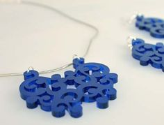 Acrylic jewelry made with a laser cutter, DIY templates, and easy to follow instructions