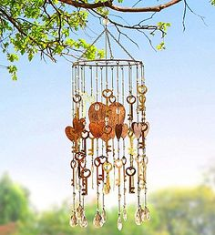 Vintage Key to My Heart Wind Chime- this is such a cute DIY project. Find old keys and personalize with beads and crystals to your heart's content.