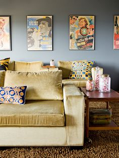 The home theater has inviting velvet chairs, funny Mexican movie posters and pillows made from vintage silk scarves. Photo by Lincoln Barbour.