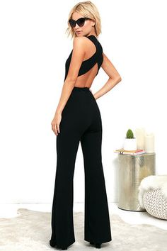 Your admirers will have a lot to say about their love for you in the Thinking Out Loud Black Backless Jumpsuit! Medium-weight knit is formed to a sleeveless bodice, with V-neck, darting, and wide straps that cross over the open back. Bit of elastic at the waist tops the wide-leg pants. Hidden back zipper.
