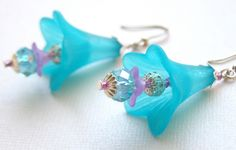 Shop for earrings on Etsy, the place to express your creativity through the buying and selling of handmade and vintage goods. Flower Jewelry, Flower Earrings, Beaded Jewelry, Silver Jewelry, Handmade Jewelry, Cluster Earrings, Wire Earrings, Blue And Purple Flowers, Flower Ornaments