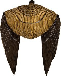 """The Elizabeth Taylor Ceremonial Cape from Cleopatra is an ornately designed piece made of thin panels of gold-painted leather adorned with hand-stitched gold bugle beads, seed beads and bead-anchored sequins.""  From the 1963 film."