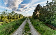 A country road that brings us to infinity - by James Wheeler.