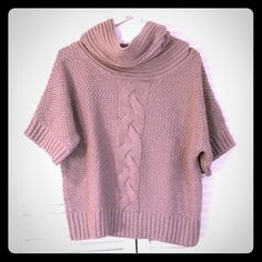 Chunky Cable Knit Sweater Beautiful cable knit poncho like sweater. Pairs well with jeans and boots. Easy to wear! Item comes from a pet free and smoke free home. I do offer a discount on bundles. Let me know if you have any questions. Only offers submitted through the offer button will be considered. Item is in excellent condition. Willi Smith Tops
