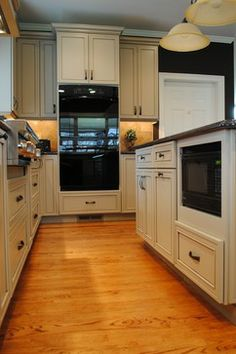 Like the clean styling on the cabinets. Mediterranean Kitchen Design Ideas, Pictures, Remodel and Decor