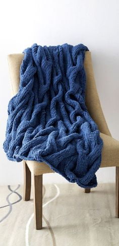 Curl up and stay cozy in this Bernat® Blanket™ Cushy Cables Knit Blanket