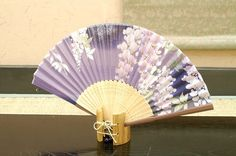 Authentic Japanese Hand Fan - Wisteria (Purple) !!!$15.00  The Japanese hand fans are an important symbol in Japan . They were used by warriors as a form of weapon, actors and dancers for performances, and children as a toy. In Japan fans are given to others as present and serve as trays for holding gifts. You would also find them sometimes used in religious ceremonies and events.
