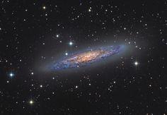 A galáxia starburst NGC 253.   24 fotos impressionantes da Terra e do Espaço