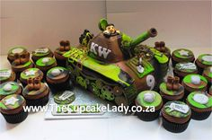army theme cupcakes, tank-shaped novelty cake, handmade sugarpaste decorations, army boots, dog-tags, grenades, camouflage